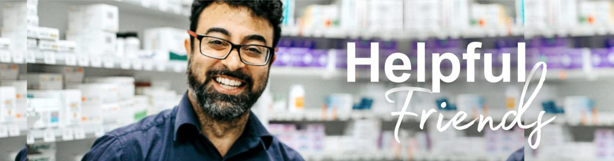 smiling pharmacist with helpful friends written